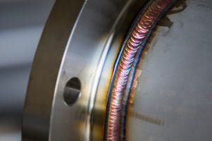 Rainbow Steel Weld Joining Pipe to Plate